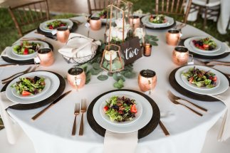 reception table, set with gold flatware and textured chargers, moscow mules, plated dinner