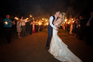 bride and groom sparkler exit, form fitting gown with textured train