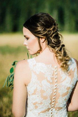 back detail of wedding dress on bride