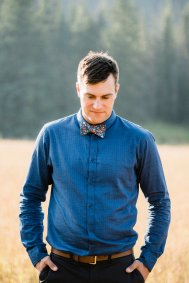 groom in shirt and bow tie