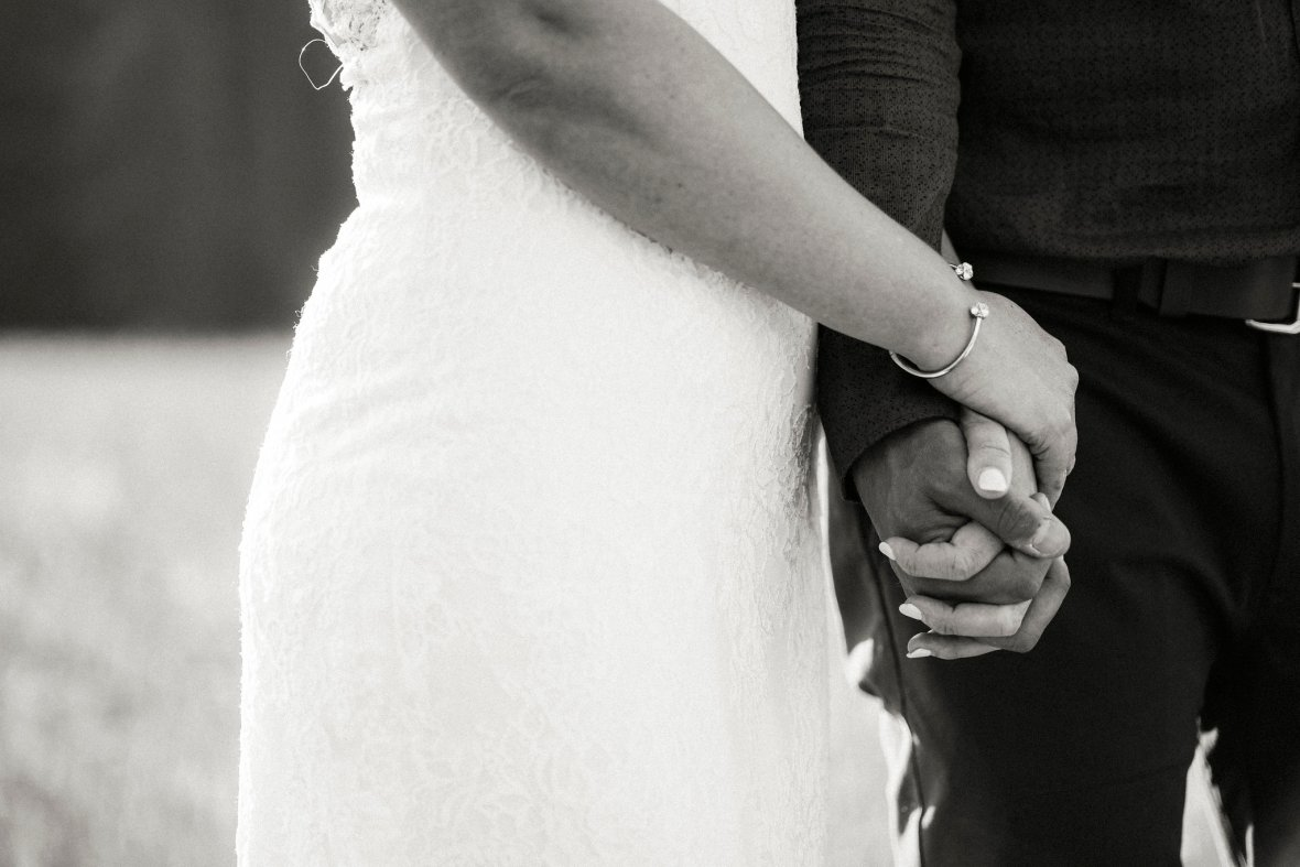 bride and groom holding hands, black and white