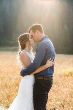 bride and groom kissing in evening light