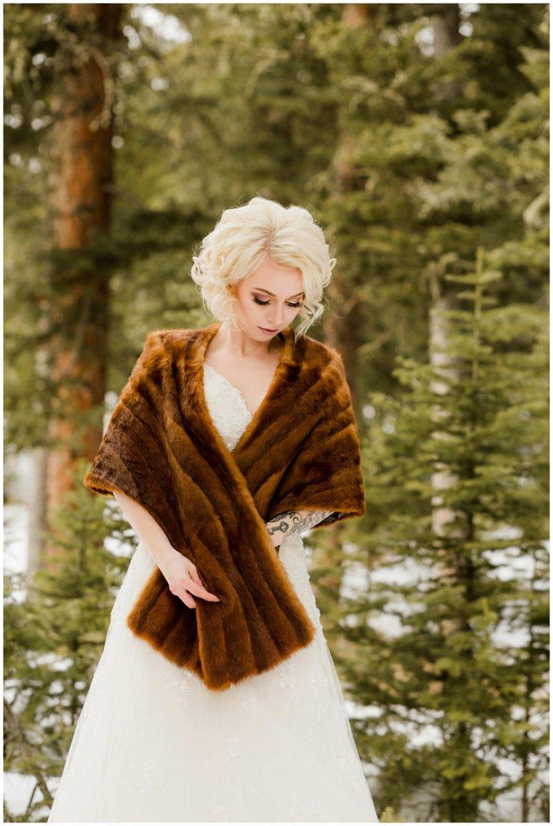 bride in faux fur shrug, winter wedding
