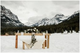 small outdoor winter wedding dining table, mountain side dining