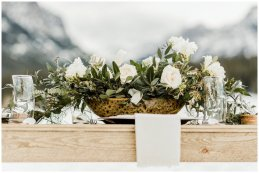 small outdoor winter wedding, wooden table, floral centerpiece