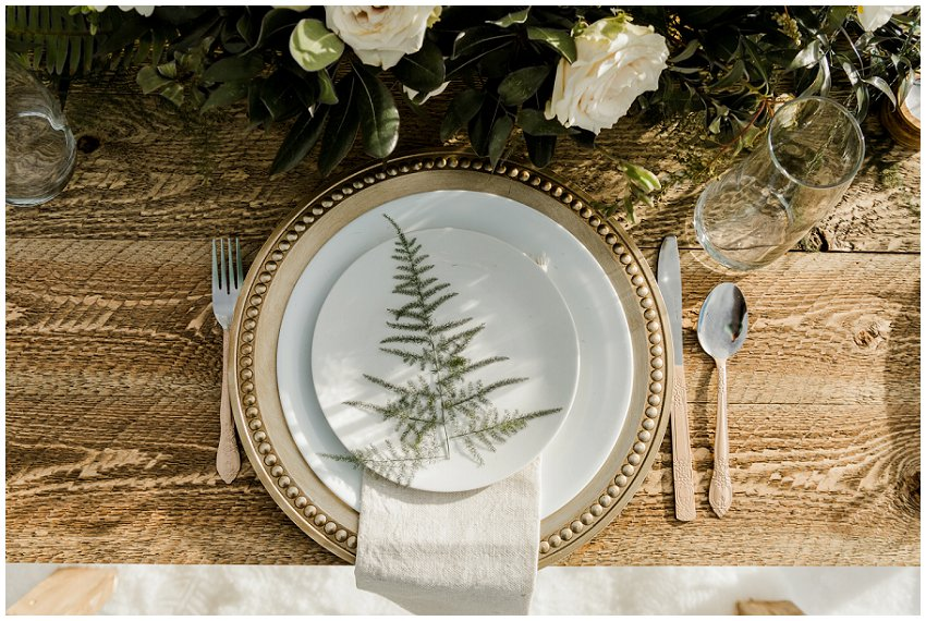 small outdoor winter wedding, wooden table, tablescape with white and gold accents