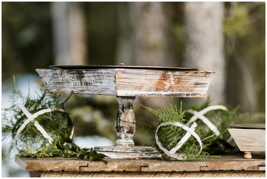 small outdoor winter wedding, dessert table with wooden cake stand, greenery decor