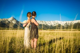 bride and maid of honor in a field
