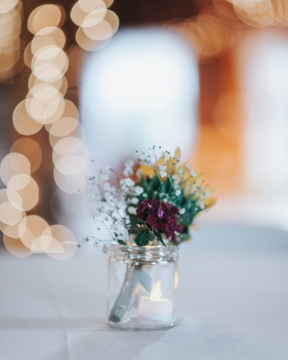 wedding jar with flowers and flameless candle