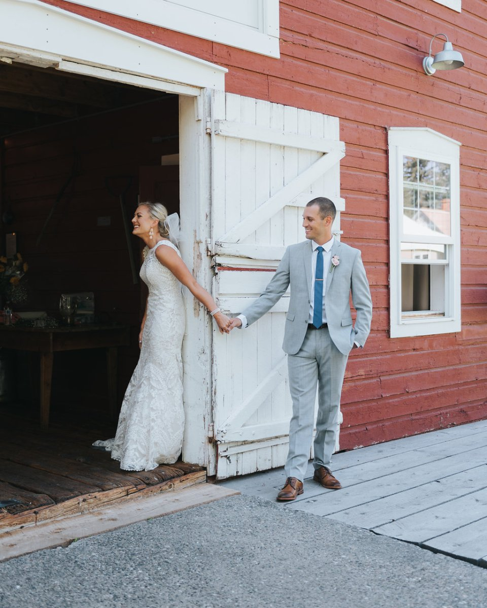 bride and groom first look at historic barn