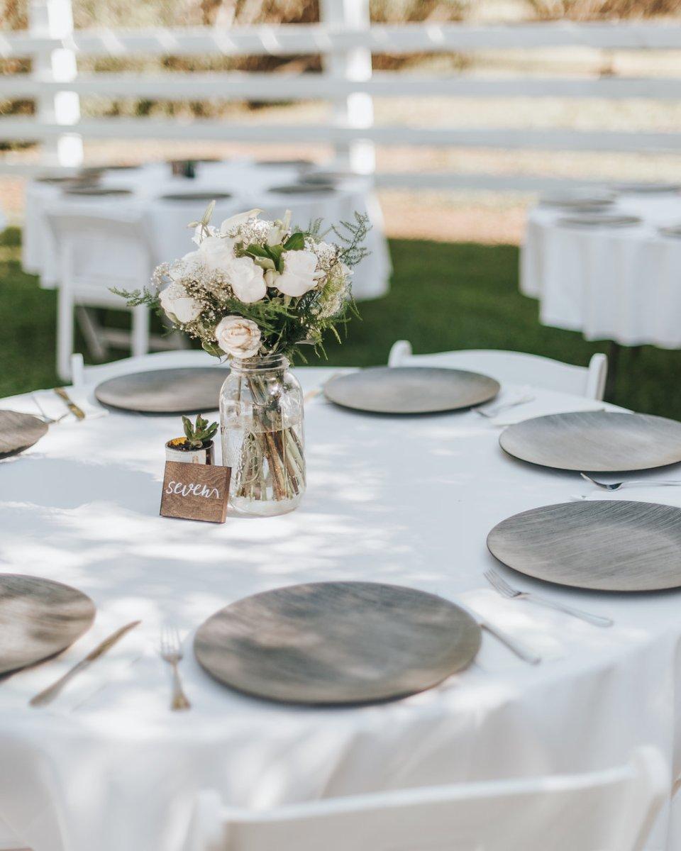wedding reception centerpiece with roses in vintage mason jars