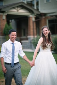 bride and grrom, walking, holding hands, laughing