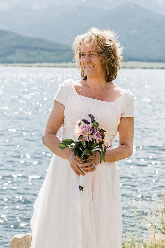 vow renewal on Hebgen Lake, West Yellowstone, MT, wife with bouquet
